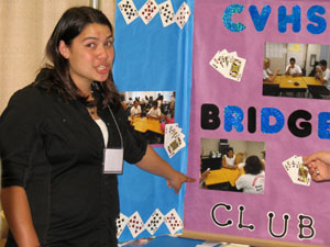 Felicia Massey points to the Chula Vista high school bridge club poster