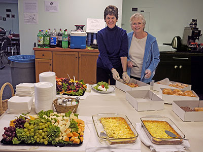Gail Dunham and Charlotte Blum serving the Monday morning hospitality at the May 2015 La Jolla unit sectional